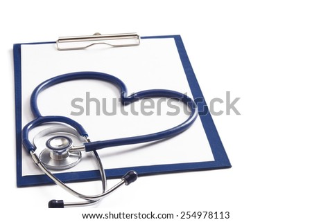 A blue statoscope in the shape of a heart on a file - stock photo