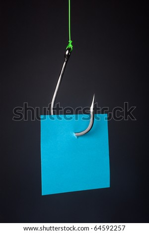 A blue stocky note with room for copy on a stainless steel fishhook. - stock photo