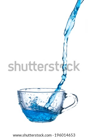 A blue water splash from cup on white background. - stock photo