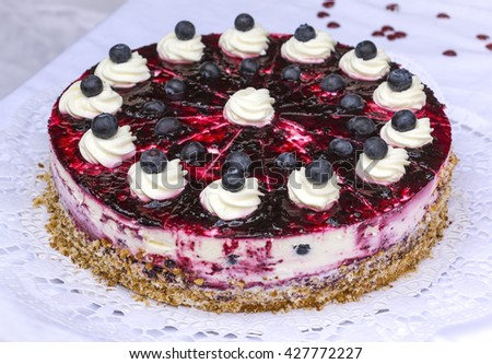A blueberry pie, a delicious cake with blueberries on the table . - stock photo