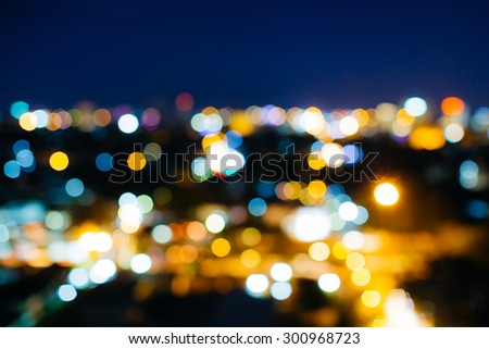 a blur bokeh picture of Chiang mai,Thailand cityscape at night time. - stock photo