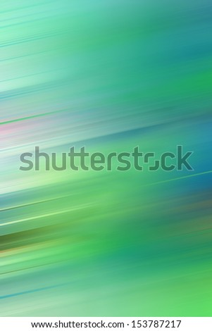 a blurred bright green coloured background - stock photo
