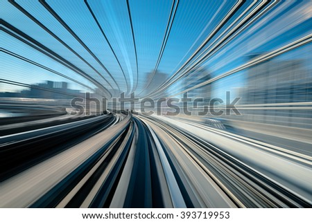 A blurred motion on the railway in Tokyo, Shiodome district.  - stock photo