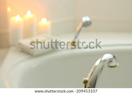 A blurred white background romantic bath with candles. - stock photo