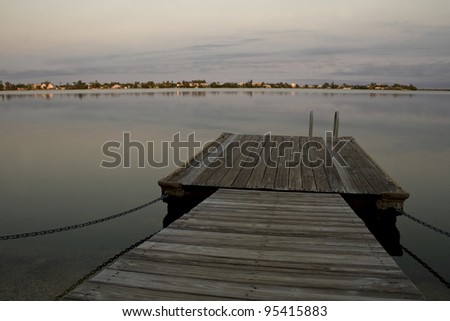 A boat dock on a bay in Key West Florida near sunset. - stock photo