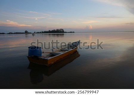 A Boat During Sunset - stock photo