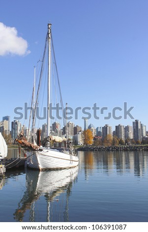 A boat is moored in English Bay near Vancouver's West End/A Marina on English Bay/A boat is docked in Vancouver's English Bay - stock photo