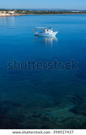 a boat on the blue sea of Sicily, Italy, Europe - stock photo