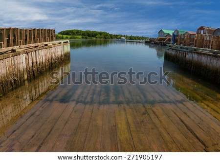 A boat slip at a commercial lobster fishing wharf in rural Prince Edward Island, Canada. - stock photo