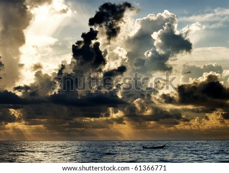 A boat with a dramatic cloud - stock photo