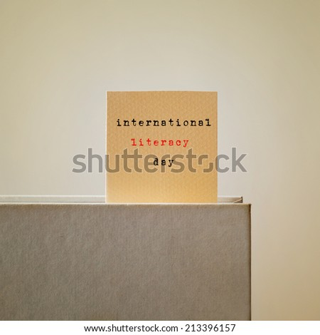 a book with a bookmark with the text international literacy day written in it, with a retro effect - stock photo
