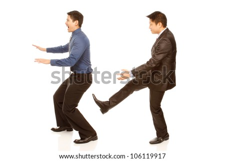 A boss kicking out an employee (isolated on white) - stock photo