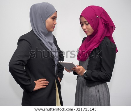 A boss reprimanding her staff. - stock photo