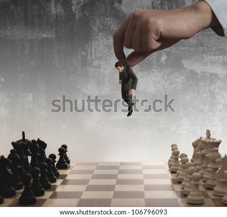 A boss uses as a pawn a businessman in a chessboard - stock photo