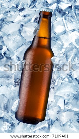 a bottle of beer is in ice - stock photo
