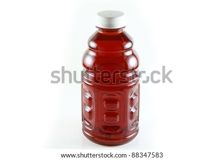 A Bottle of cranberry juice isolated on white - stock photo