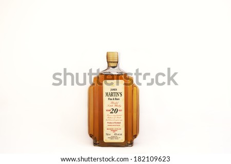 A bottle of fine and rare 20 years old James Martin's whisky. Produce of Scotland. Illustrative editorial, the photo was taken on March 15, 2014 in Porto, Portugal - stock photo