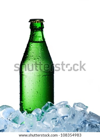 A bottle of mineral water with ice on a white background - stock photo