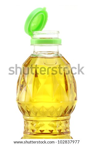 A bottle of Palm kernel Cooking Oil with green lid opened, isolated on white background - stock photo