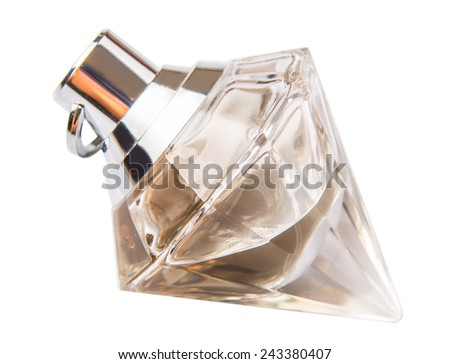 A bottle of perfume over white background  - stock photo
