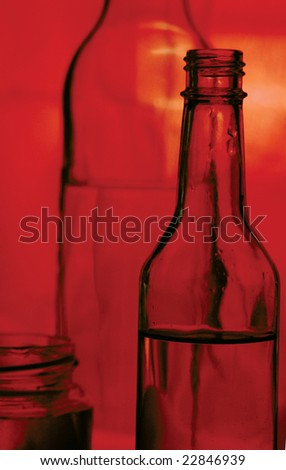 A bottle of red-colored still life - stock photo