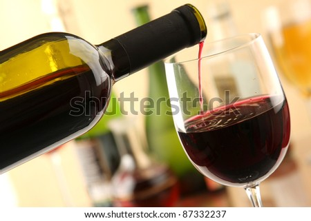 A bottle of red wine and  glasse - stock photo