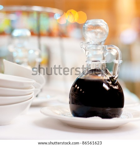 A bottle of soy sauce on a table/ Soy sauce in a bottle - stock photo