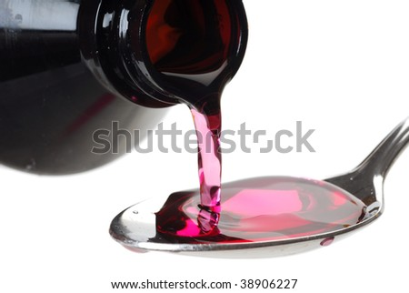 A bottle pouring cough syrup into a spoon with a white background - stock photo