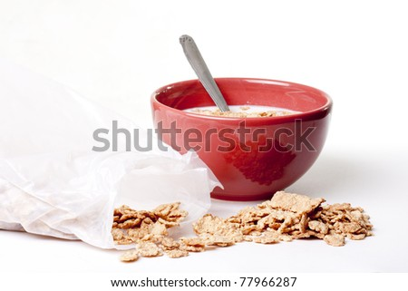 a bowl full of cereal with milk - stock photo