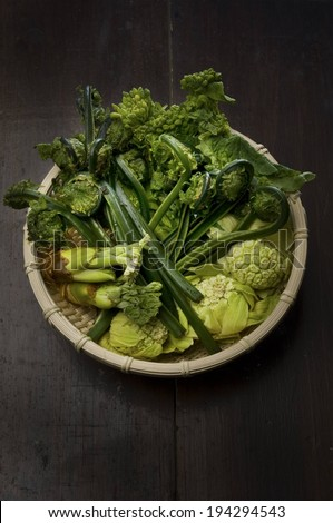 A bowl full of different types of green vegetables. - stock photo
