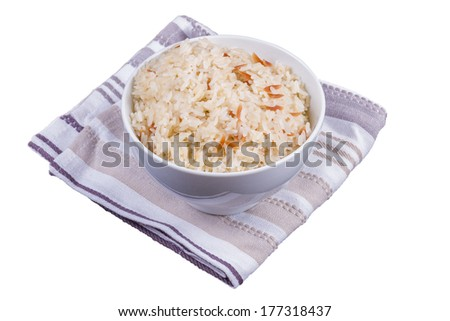 A Bowl of Cooked Rice on a Kitchen Towel Isolated on a White Background - stock photo