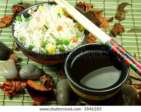 a bowl of fried rice with vegetables and soya sauce - stock photo