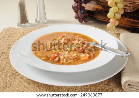 A bowl of hearty chicken sausage gumbo soup with rice - stock photo