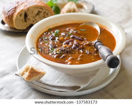 A bowl of homemade chili bean soup with meat, selective focus - stock photo