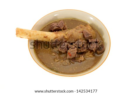 A Bowl Of Lamb Knuckle Mutton Soup Served In Indian Style - stock photo