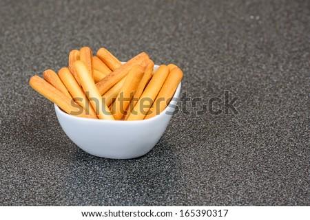 A bowl of mini bread sticks - stock photo