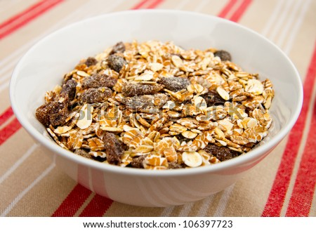 A bowl of muesli for breakfast - stock photo