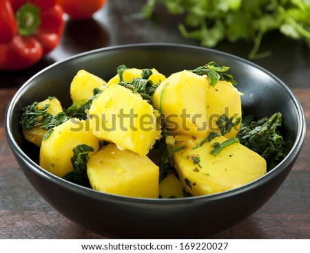 A bowl of Saag Aloo an Indian Restaurant cuisine dish - stock photo