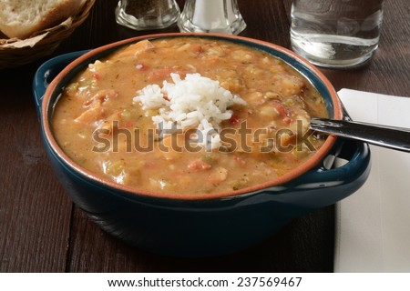 A bowl of smoked sausage and chicken gumbo with white rice - stock photo
