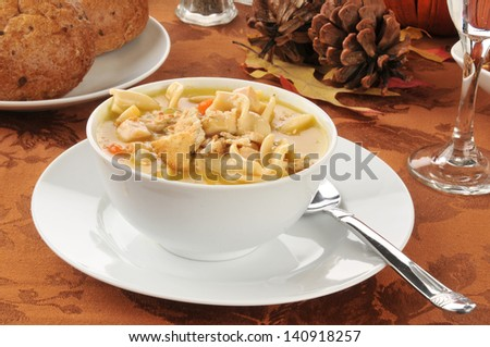 A bowl of turkey or chicken noodle soup - stock photo
