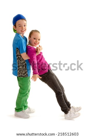 A Boy and Girl Hip Hop Dance Partners Practice their Moves - stock photo