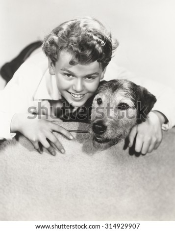 A boy and his dog - stock photo