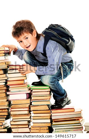 A boy climbing the stairs of books. Education. Isolated over white. - stock photo