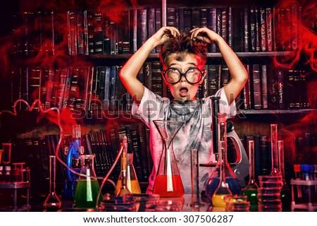A boy doing experiments in the laboratory. Explosion in the laboratory. Science and education. - stock photo