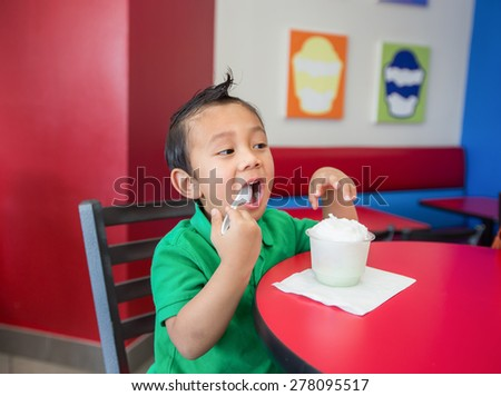 A Boy eating yogurt ,  Asian  - stock photo