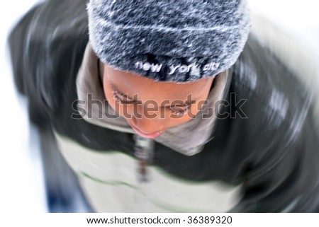 a boy has fun playing in the snow - stock photo