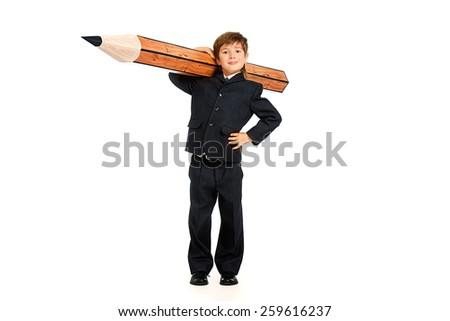A boy in school uniform posing with a huge pencil. Educational concept. Isolated over white. - stock photo