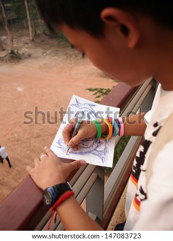 a boy making freehand sketch drawing  - stock photo