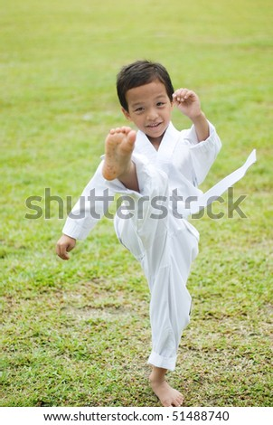 A boy perform a front kick style - stock photo