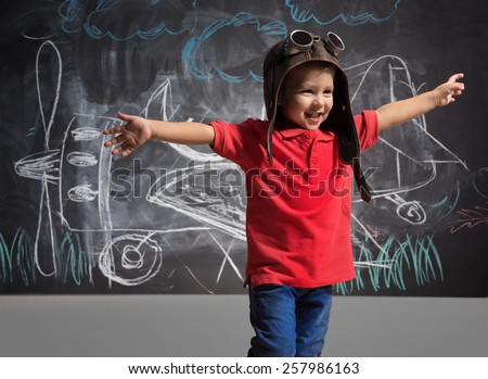 A boy plays in the pilot - stock photo